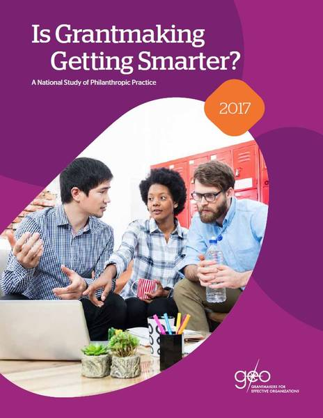 This cover has purple shapes that look like beans. In the middle is a picture of three business professionals looking at a computer and talking to one another.